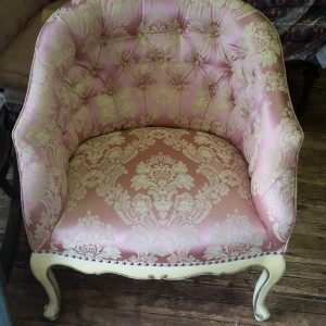Reupholstered pink and white tufted back chair