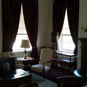 Corner window pinch pleated draperies with tie backs