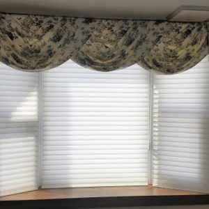 Swag & jabot valance over sheer shades in Chester Springs home.
