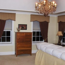 Master bedroom shaped cornices and draperies