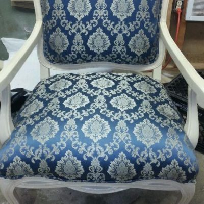 Reupholstered occasional chair with cut out back