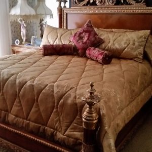 custom king size quilted comforter in a diamond pattern with 2 quilted king shams, 2 bolster billows and 1 knife edge pillow with button center