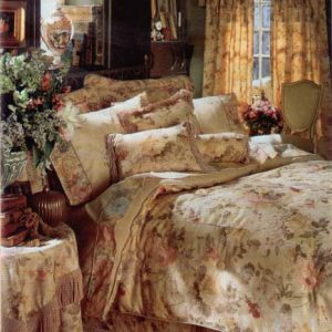 Button tufted comforter, shams and pillows with coordinating table cover with bullion fringe.