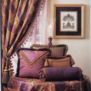 Various styles of decorative throw pillows and trims coordinating with drapery panel and table cover.