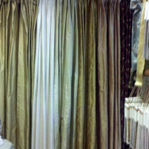 Display showing different styles of draperies.