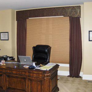 Honeycomb shade, shaped cornice, puddled drapes