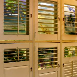 N J Rose Decorating showroom shutter display that depicts various styles of available plantation shutters.