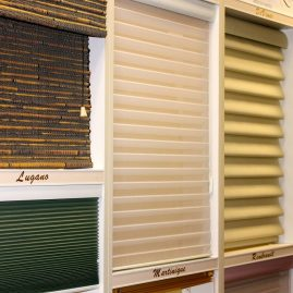 N J Rose showroom: window blind display, Lugano, Marinique, Rembrandt…