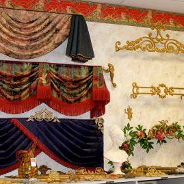 N J Rose showroom display showing a variety of valances and decorative curtain rods and brackets.