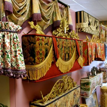 NJ Rose Decorating showroom display of various window treatment styles and designs.