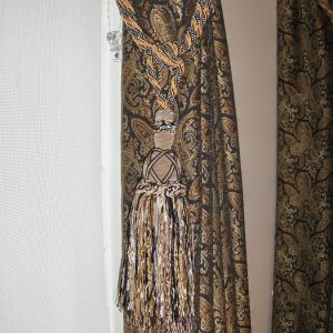 Draperies with large tassel tie back