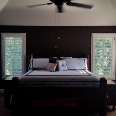Plantation shutters cover windows of bedroom in Pottstown, PA