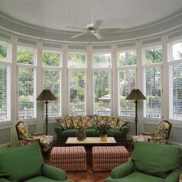 Garden room with single panel plantation shutters w/ tilt bars.