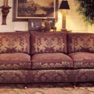 Three seat sofa showcasing large lion crest print centered on each back cushion.