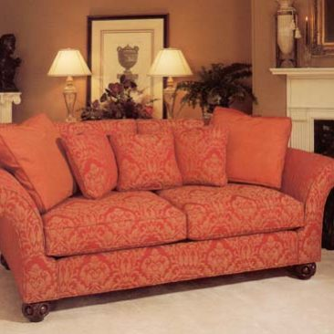 Brocade covered sofa and contrast pillows.
