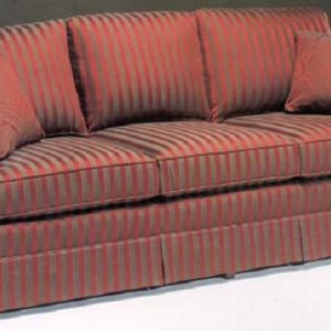 Traditional three seat sofa with skirt and accent pillows.