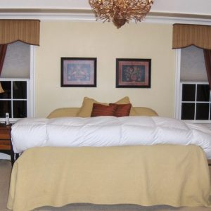 shaped cornices over pulled back drape and honeycomb shades