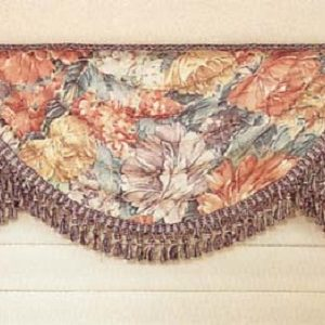Wrapped swag valance with tassel fringe.