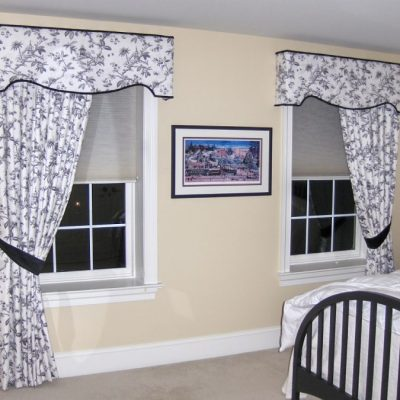 toile shaped cornice over one way pulled back drapery