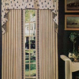Box pleat valance in contrast fabrics over top of pinch pleated draperies with appliquéd edging and border.
