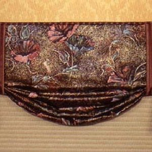 Butterfly valance in contrasting fabrics.