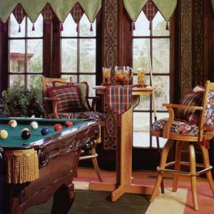 Game room V – Point valance in contrast fabrics and welting with tassels. Custom covered pub chairs with coordinating pillows and table runner with decorative trim.