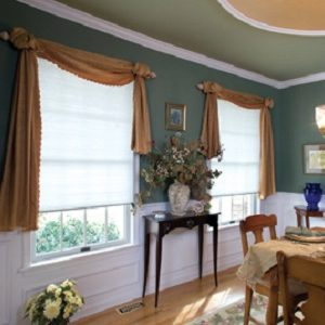 Cordless cellular honeycomb shade with scarf style swag valance over top.