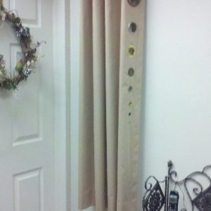 Example of Grommet drapery showing different size grommets available.